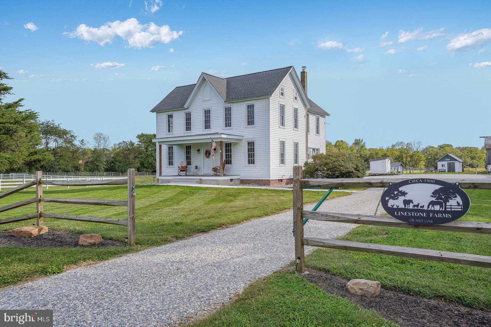 """Rare Opportunity to own """"LineStone Farms""""...  Restored 1900 Farmhouse on 10.6 Acres(10.1 NCC & 1/2 Acre Kent County MD).  To the bones this house has been loved from new electric, new plumbing, spray foam insulated, new drywall, new windows, new roof, 2 HVAC systems with metal insulated duct, to what you can actually see in the photos.  Refinished original hardwood floors downstairs (new hardwood in kitchen) & restored staircase showing off the original layers of paint keep the history alive!  The kitchen has seen a high end remodel with 42"""" soft close cabinetry complete with crown and base mouldings.  Hammered copper farmhouse sinks is just one of many custom touches.  First floor master suite with custom full bath and walk-in closet.  Outside is the 4 car detached man cave and approx 5 acres of fenced in pastures with multiple run-in sheds/outbuildings.  Riding trails in DE and MD all around.   Approximately 3 Acres of wooded land in the rear adjoining farm, MD State Lands, and a stream bringing the game right to your stand.  Standard gravity septic design is permitted and will be installed prior to closing.  So much potential...a roadside produce stand, horse boarding, etc.  Just an amazing piece of property...  Owner is a licensed real estate broker."""