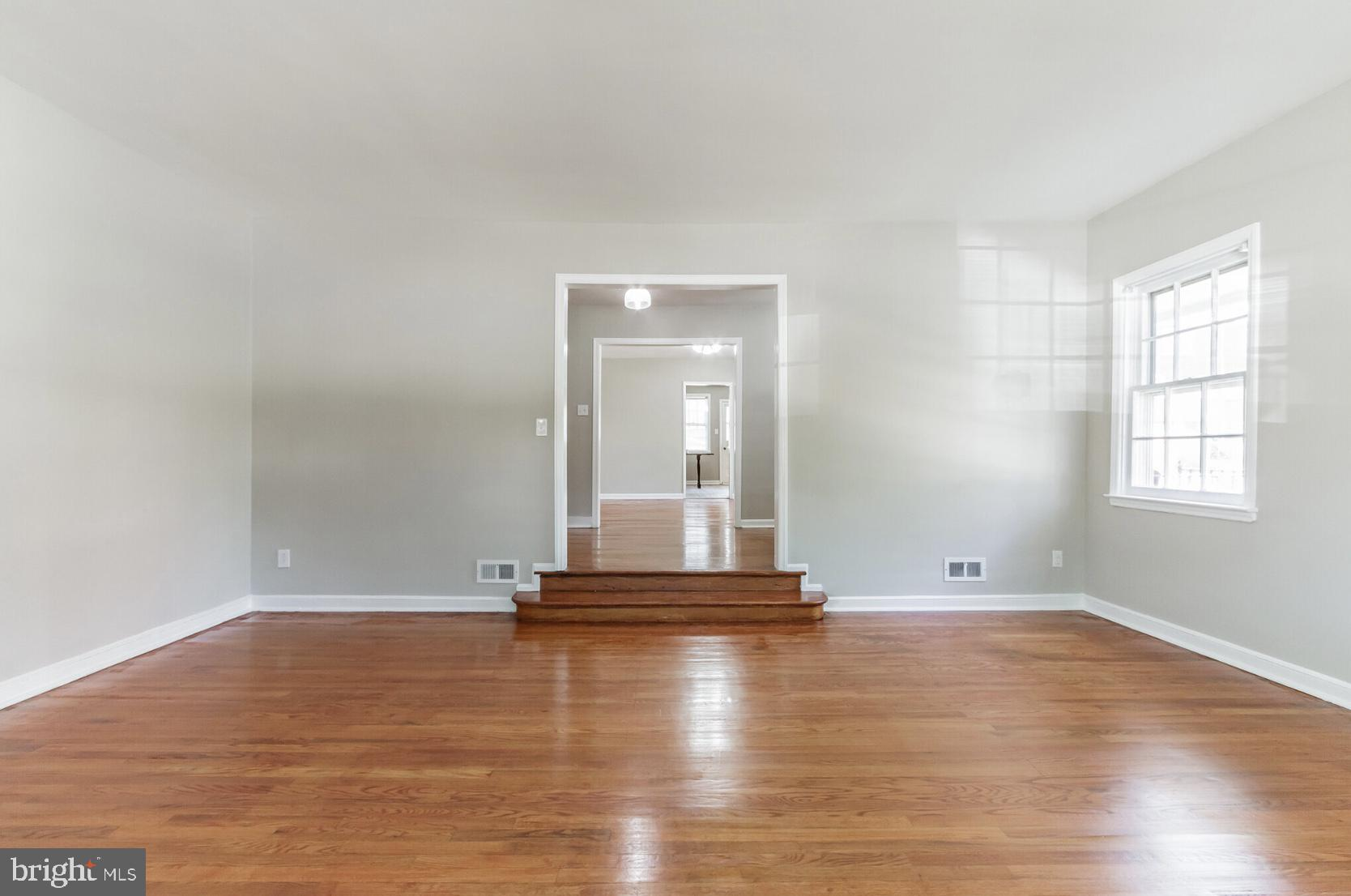 You do not  want to miss this North Wilmington beauty.  This home is an absolute GEM! The layout, size, and location of this home rarely becomes available.  The main level has an eat in kitchen,  that opens to a cozy family room.   From the foyer you can access the large dining room or step down into the beautiful and extremely spacious formal living room. These rooms  flow seamlessly and are great for family gatherings.   A half bath off the foyer completes the main level.  As you make your way to the upper level you will  immediately take notice of the wide stairs and high ceiling  in the stairwell.  The upper level  host 3 bedrooms and 2 full baths; and the bedroom  sizes will not disappoint!!   This entire home has been freshly painted, and has the original beautiful hardwood flooring  throughout the entire home, (except baths, kitchen, and family room).  Put this one on your list!