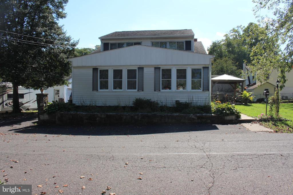 Welcome home to this five-bedroom traditional home in the heart of Oakford, Pennsylvania! You won't find a similar property in this area, so don't delay as this home is ready for you to add your own personal touches. On the first floor, find a living room/dining room, as well as a bonus room ready to be made into an office or craft room. The open kitchen and living room concept is perfect for entertaining, and the stainless-steel appliances were recently installed. A living room pellet stove helps save on the electric bill, alongside the opportunity to enhance the heating system to your liking. A sliding glass door leads to the outdoor patio. Laundry is conveniently located on the first floor, as is the master bedroom, which sits next to a newly renovated full bath. Upstairs, find four additional bedrooms and another newly renovated full bath. Each floor offers an abundant amount of storage space. Spend your fall relaxing under the gazebo next to a fire, as the large yard offers plenty of cleared space for all the outdoor activities you and your family love, year-round. You will also find a two-car detached garage. Enjoy a true community feel in this neighborhood, which offers a community center and rental venue available for personal event needs. And your new home will be conveniently located shopping and major roadways including the PA Turnpike and Route 1. This property is being sold as is, perfect for you to make it the home of your dreams!