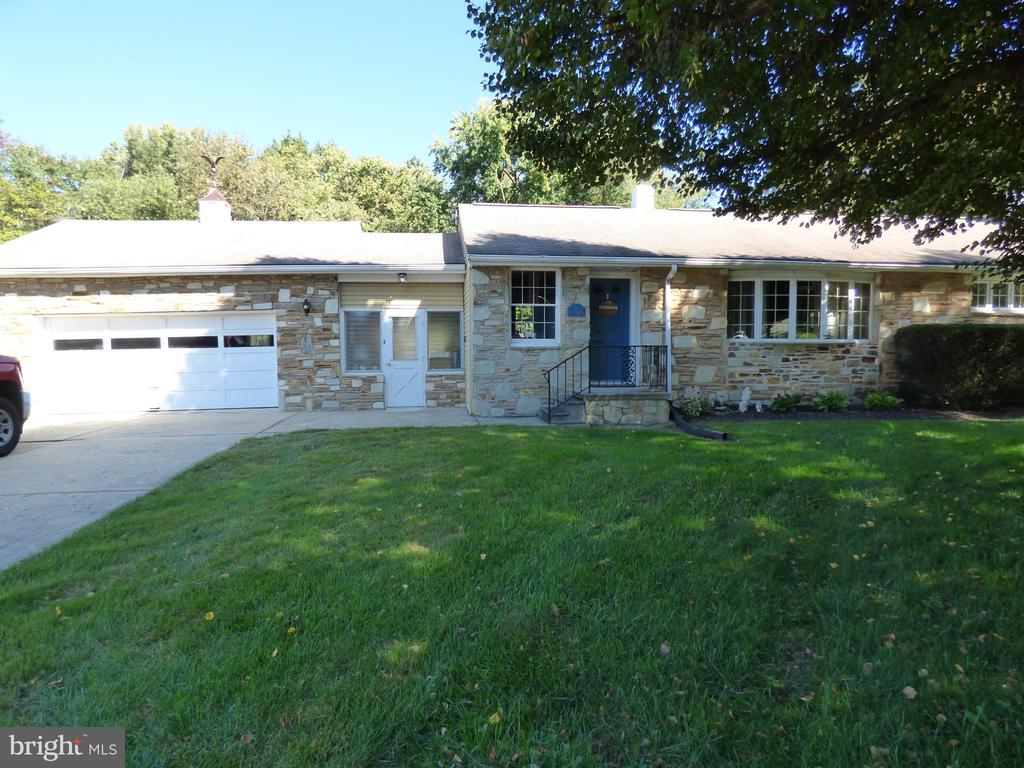 This very well maintained stone front rancher in Glen Ashton Farms. Great little neighborhood away from the Hussle but everything is easily accessible. 95, Turnpike, Shopping. Large concrete driveway with 2 car garage. Freshly redone hardwood floors thru-out. New kitchen with shaker cabinets, Granite counter tops, Upgraded stainless appliances and new wood flooring. Sunroom/ Breese way between house and garage goes out to good sized deck and a very large back yard that backs up to 7 acers of township owned land keep it very private.  3 nice sized bedrooms all with hardwoods. Full bath totally redone ceramic tile flooring Heated, Full sized shower beautiful marble tile walls, new Vanity. Full basement with access to back yard from basement. Basement has a full waterproofing system built in. Also there is a powder room in the basement.
